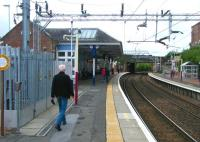 View along the westbound platform at Coatbridge Sunnyside on 10 August.<br><br>[Veronica Clibbery&nbsp;10/08/2013]
