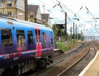 About to restart its journey at Haymarket platform 4 on 9 August is the TransPennine 12.11 Edinburgh Waverley - Manchester Airport. The train is signalled for the Carstairs route at Haymarket East Junction.  <br><br>[John Furnevel&nbsp;09/08/2013]