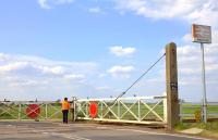 Heather opening the level crossing gates at Shippea Hill in May 2011.<br><br>[Ian Dinmore&nbsp;21/05/2011]