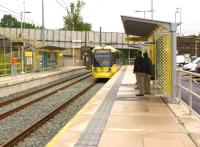 A Metrolink tram calls at Derker on a Rochdale to East Didsbury service on 31 July 2013.<br><br>[John McIntyre&nbsp;31/07/2013]