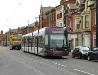 Pulling away from the penultimate northbound stop, <I>Flexity</I> 002 moves back towards the centre of North Albert St in Fleetwood town centre on 10 August and heads for Fleetwood Ferry, closely followed by a Blackpool bus. <br><br>[Mark Bartlett&nbsp;10/08/2013]