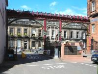 The exit from the Caledonian Railway's Princes Street station onto Rutland Street in August 2013. The framework and metal gates still survive, although nowadays the station and platforms that once stood behind the camera have given way to car parking and offices serving Edinburgh's financial district.<br><br>[John Furnevel&nbsp;09/08/2013]
