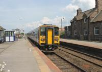 A pair of Class 153 single units calling at Bootle on a service from Barrow to Carlisle on 27 July. The station building is a private residence now but the signal box and its semaphores still control the block section and protect the level crossing.<br><br>[Mark Bartlett&nbsp;27/07/2013]