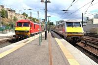 The 14.00 Edinburgh Waverley - London Kings Cross pulls out of the station into bright sunshine on 9 August, passing DBS 90029 in the east end locomotive bay prior to entering the Calton Tunnel. <br><br>[John Furnevel&nbsp;09/08/2013]