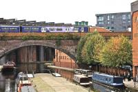 A Northern Rail class 150 passes over Castlefield Basin, Manchester, in September 2009.<br><br>[Ian Dinmore&nbsp;28/09/2009]