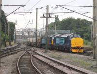 Immaculate DRS EE Type 3 37425 <I>Concrete Bob</I> hauls DRS 57004 and four flasks through Preston on a Crewe to Sellafield train on 22nd August 2013. <br><br>[Mark Bartlett&nbsp;22/08/2013]