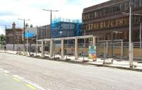 Looking south across Haymarket Terrace on 9 August 2013. Station redevelopment work continues in the background beyond the tram stop, with the 1842 E&G station building on the far left of the picture.<br><br>[John Furnevel&nbsp;09/08/2013]