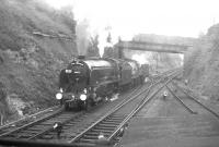 30925 <I>Cheltenham</I> and 40646 running round at Wetherby South Junction on 13 May 1962 under the A661 road bridge. The train standing in Wetherby station behind the camera is the RCTS <I>East Midlander No 5</I> on its way from Church Fenton to Harrogate. The run round here was necessitated by the closure of the direct line between Wetherby East and West Junctions in 1961. Wetherby station closed in January 1964 and the site is now a walkway and car park. [See image 54833]<br><br>[K A Gray&nbsp;13/05/1962]
