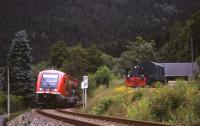 On 29th June 2013, a Schwartzatalbahn branch train for Katzhuette passes the Obstfelderschmiede station chord siding (with diesel shunter and elderly DB wagon) linking to the Oberweissbacher Bergbahn funicular. <br><br>[David Spaven&nbsp;29/06/2013]