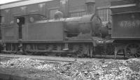 N15 0-6-2T 69150 stands alongside V3 2-6-2T 67669 in the sidings along the south side of St Margarets shed in February 1962. 69150 would be withdrawn in October that year and cut up at Inverurie Works the following February. The V3 was already 'stored', at this stage having been officially withdrawn 5 months earlier. It was cut up at Darlington Works the following month. <br><br>[K A Gray&nbsp;03/02/1962]