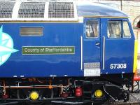 <I>County of Staffordshire</I> nameplate attached to 57308, now freshly repainted in DRS livery, seen stabled near Crewe platform 12 whilst on 'Thunderbird' standby duty on 30 August.<br><br>[David Pesterfield&nbsp;30/08/2013]