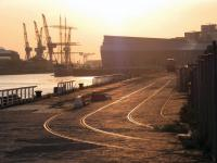 The cranes of the Govan shipyards are silhouetted by the evening sun on 7 May 2013. View west from Yorkhill Quay with Glasgow's Riverside Museum in the right background.<br><br>[Colin Harkins&nbsp;07/05/2013]