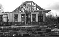 As reported in August 2013 [see news item] the former Dalnaspidal station building, subsequently relocated to Aviemore, is being dismantled once more and moved to the Insider Festival site. The photograph shows the building being re-assembled  at the Strathspey Railway's Speyside station in April 1979 following its move from Dalnaspidal.<br><br>[John McIntyre&nbsp;/04/1979]