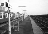 Looking north through Cambridge station on 18 January 1976. One through platform with bays at either end, how times have changed; goodbye steam heat Mark 1 coaches and the freight sidings on the right; hello to 25KV and Networker EMUs. The platform trolley looks a little lost.<br><br>[John McIntyre&nbsp;18/01/1976]