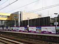The new Wakefield Westgate main station building, to the north end of the up platform, is rapidly nearing completion. This view shows the platform side exterior on 4 September 2013.<br><br>[David Pesterfield&nbsp;04/09/2013]