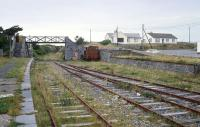 The Tralee - Fenit branch of the Great Southern & Western Railway was finally closed in 1987 but lingers on.�There was an attempt to revive it as a preserved line, which explains the presence of a Ruston shunter, but the scheme was abandoned.� View back towards Tralee in 1991. [See image 44546] <br><br>[Bill Roberton&nbsp;//1991]