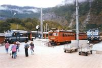 Scene at Flam terminus on 26 June 1994. An NSB class 69 EMU awaits departure with the next service to Myrdal, flanked by a pair of X10 units, borrowed for use during the summer peak. The X10s were popular with tourists due to their larger windows. The SL (Stockholm Commuter Rail) unit on the right was being used for driver training.<br><br>[John Furnevel&nbsp;26/06/1994]