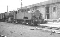 Gresley J50 0-6-0T no 68933 stands with a WD Austerity 2-8-0 alongside Wakefield shed on a March day in 1961. <br><br>[K A Gray&nbsp;12/03/1961]