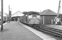 Birmingham Type 2 26023 waits at Thurso on 23rd September 1976 with the teatime departure (about 17.25) for Georgemas Junction, where the coaches will be attached to the Wick - Inverness service (powered on this day by 26046). <br><br>[Bill Jamieson&nbsp;23/09/1976]