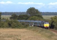 One of the NXEA loco-hauled Great Yarmouth - Norwich services coming off the Berney Arms route on 2 July 2011. 1V43 is seen from Mill Road Bridge approaching Reedham Junction behind DRS 47810.<br><br>[Ian Dinmore&nbsp;02/07/2011]