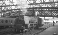 Relief engine awaiting the arrival of the 9.25am Crewe - Perth at Carlisle on 26 March 1964 is 46257 <I>City of Salford</I>.<br><br>[K A Gray&nbsp;26/03/1964]