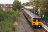 Merseyrail 508137 approaches the buffers as it arrives at Ormskirk on 15 September 2013 with a service from Liverpool. [See image 15790] for a similar view north from Derby Street bridge some 22 years earlier when the vegetation was less prolific.<br><br>[John McIntyre&nbsp;15/09/2013]