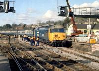 The PW team seems to be looking on a little pensively (as do one or two of the passengers) as 50003 <I>Temeraire</I> slowly rumbles over new track and pointwork into Exter St Davids station in 1986 with a Paddington bound train.<br><br>[Ian Dinmore&nbsp;//1986]