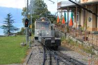 With Lake Geneva far below, units 305 and 301 propel two wagons for the Rochers de Naye summit hotel into the passing loop at Caux station. Although 305 appears identical to its 1983 sister units it was only built in 2010.<br><br>[Mark Bartlett&nbsp;09/09/2013]