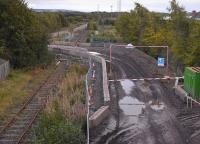 View south from the B6415 bridge�at Millerhill village over the course of the Waverley Route and the Glencorse branch (latterly serving Bilston Glen Colliery). Cutting across the trackbed is a new access route to a Borders Railway construction site.� The signal seems a bit redundant...��Taken at dusk on 21 September 2013. [See image 37199]<br><br>[Bill Roberton&nbsp;21/09/2013]