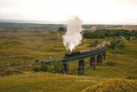 After a stop at Rannoch Station on 22 September, K4 No.61994 <I>The Great Marquess</I> hauls the heavily laden <I>West Highlander Railtour</I> over the viaduct north of the station. The rails are wet and the engine's sanders are working as it blasts its way up the gradient.<br><br>[John Gray&nbsp;22/09/2013]