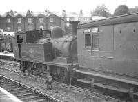 Scene at Cowes, Isle of Wight, on 16 August 1961 where  Adams class O2 0-4-4T no 30 <I>'Shorwell'</I> has recently arrived with a train from Ryde. <br><br>[K A Gray&nbsp;16/08/1961]