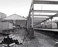 The original Haymarket train shed in the course of dismantling in late 1982 as a Waverley bound DMU waits at platform 1. Much of the structure would reappear as part of the SRPS station at Boness, while the trackbed on the right would also reappear 25 years later as platform 0 [see image 17459].<br><br>[Bill Roberton&nbsp;//1982]