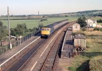 A Waterloo to Barnstaple service arrives at Newton St Cyres in the 1980s.<br><br>[Ian Dinmore&nbsp;//]