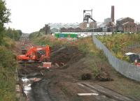 Work being carried out on the trackbed near the former Lady Victoria Colliery on 27 September 2013. The site of the planned Newtongrange station is in the left background.<br><br>[John Furnevel&nbsp;27/09/2013]