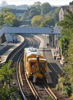 A Network Rail <I>stoneblower</I> runs north through Inverkeithing  station on 29 September.�New rails have been set out here ready for installation.<br><br>[Bill Roberton&nbsp;29/09/2013]