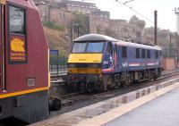 Scotrail-liveried sleeper locomotive 90024 and <I>Thunderbird</I> 67020 at the east end of Waverley on 24 September 2013.<br><br>[Bill Roberton&nbsp;24/09/2013]
