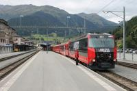 The Rhaetian Ge 4/4 III fleet are handsome and powerful (4160hp) locos that wouldn't look out of place on the standard gauge network. All twelve are in different advertising liveries but that on 648 <I>Susch</I> particularly complements the red coaching stock. The guard and driver of a Davos to Landquart service chat at Klosters while waiting for departure time.<br><br>[Mark Bartlett&nbsp;15/09/2013]