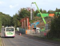 Saturday morning construction work on the new Gore Glen bridge, seen here looking north on 5 October 2013. The structure will carry the Borders Railway across the A7 between Newtongrange and Gorebridge.<br><br>[John Furnevel&nbsp;05/10/2013]