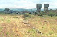 View south over the former Down Yard at Millerhill in 1992 with Monktonhall Colliery in the background.  The Borders Railway will veer to the right here through what is now a forest!<br><br>[Bill Roberton&nbsp;//1992]