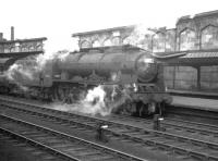 A summer Saturday <I>through</I> service, photographed alongside platform 4 at Carlisle on 4 August 1962. The train is the 11.50am Glasgow Central - Manchester / Morecambe. Locomotive in charge is Polmadie Royal Scot no 46121 <I>Highland Light Infantry, City of Glasgow Regiment</I>. <br><br>[K A Gray&nbsp;04/08/1962]