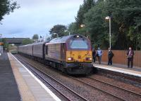 67011 brings the 07.36 Cardenden - Edinburgh commuter train into Rosyth on 7 October.� That <I>Metro</I> must be interesting!<br><br>[Bill Roberton&nbsp;07/10/2013]