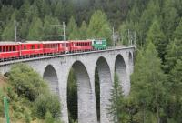 The amazing loops, spirals, tunnels and viaducts of the Rhaeitian Railway Albula line have been made a UNESCO world heritage site. Ge 4/4 III electric loco No. 647 <I>Grusch</I> crosses one of many tall slender structures on a Chur to St. Moritz train shortly after leaving Bergun. <br><br>[Mark Bartlett&nbsp;16/09/2013]