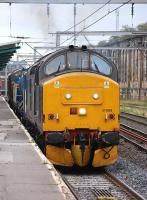 37688 and 37409 roar away from a signal stop at Carlisle on 11 October, taking an RHTT service from the Tyne Valley back to DRS Kingmoor.<br><br>[Bill Roberton&nbsp;11/10/2013]