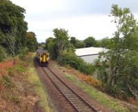 The 09.41 Girvan - Kilmarnock runs round the curves shortly after leaving Maybole on 23 September 2013. On the right is the site of the original Maybole terminus, which later became the goods station, all since redeveloped for industrial use.<br> <br><br>[Colin Miller&nbsp;23/09/2013]