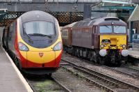 <I>The Statesman</I> Rail charter from Cambridge to Fort William at Carlisle on 11 October behind West Coast 57314 stands alongside a Virgin Pendolino on a Glasgow Central - London Euston service.<br><br>[Bill Roberton&nbsp;11/10/2013]