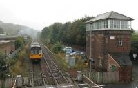 Pulling away from a stop at Prudhoe on 4 October, Northern 142092 passes the tall signalbox as it heads west along the Tyne Valley towards Hexham. <br><br>[Mark Bartlett&nbsp;04/10/2013]
