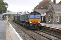 DRS 66303 passes through a wet Pitlochry station on 9 October with the 4D47 Inverness - Mossend intermodal.<br> <br><br>[Bill Roberton&nbsp;09/10/2013]