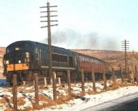 The 9.23am ex-Waverley passes a snowy Whitrope summit on 3 January 1967 en route to Carlisle. The locomotive is one of the early <I>Peaks</I>.<br><br>[Bruce McCartney&nbsp;03/01/1967]