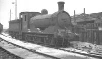NB J36 0-6-0 no 65293 photographed in the sidings alongside Eastfield shed on 4 March 1963. The locomotive had been officially withdrawn from Carlisle Canal shed approximately 4 months earlier and was eventually cut up at Motherwell Machinery & Scrap, Wishaw, in April 1965. [Additional: Peter Hughes noticed the locomotive at Gourock in April 1963 in use as a stationary boiler for carriage heating].<br><br>[K A Gray&nbsp;04/03/1963]