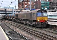 Vying for the award of filthiest main line diesel seen by the photographer are 66424 and 66430 at Carlisle on 11 October on WCML RHTT duty.<br><br>[Bill Roberton&nbsp;11/10/2013]